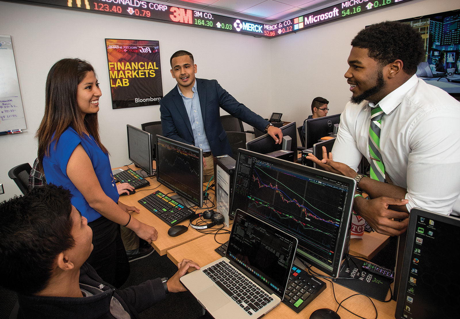 Students in the stock market room